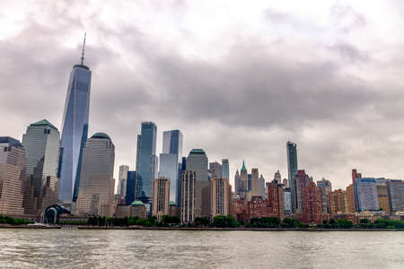 Skyscrapers of Manhattan view from the boat. Фото со стока