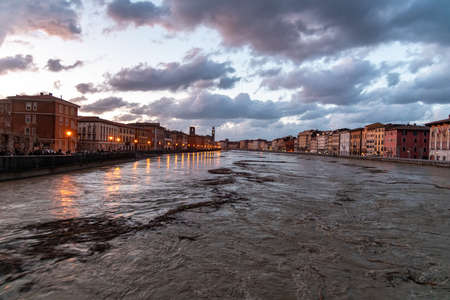 View of the Arno river from the bridge during the swollen.