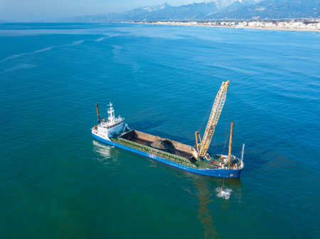Aerial view from the drone of a dredging vessel seabed.