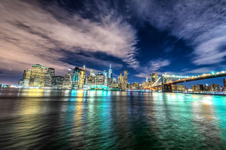 Skyline of Manhattan and Brooklyn bridge, night view.