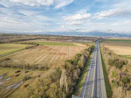 Aerial drone view of the highway between country areas, Tuscany, Italy.
