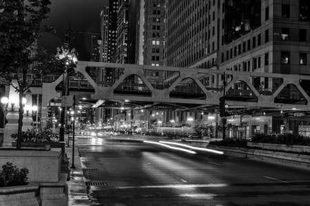 Chicago, night traffic between bridges and skyscrapers.
