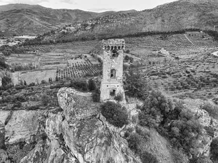 Ancient tower on the cliff of a small hill, Tuscany, Italy.