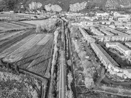 Aerial view from the drone of the railway that runs along a small town in Tuscany.