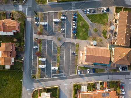 Aerial view fron drone about a parking with cars.