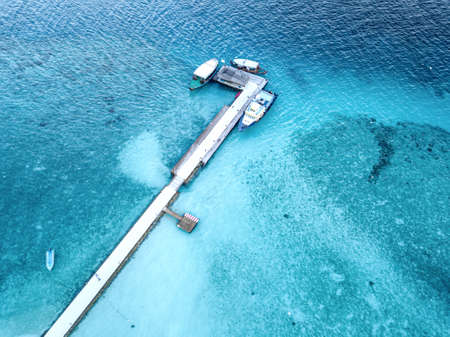Aerial view of the docking dock of the boats and the reef around.