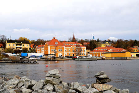 Houses and harbour at Skansen Stockholm next to the river and boats