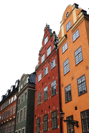 Typical Gamla Stan houses in red and orange colors in the autumn in Stockholm Sweden