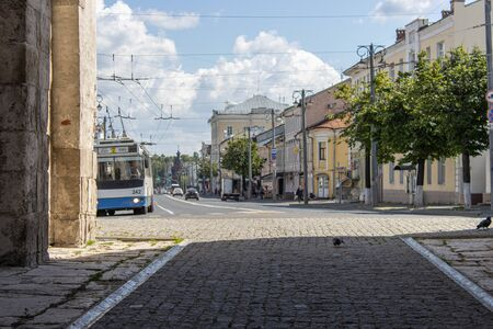 Old city street view and trolleybus driving Banque d'images
