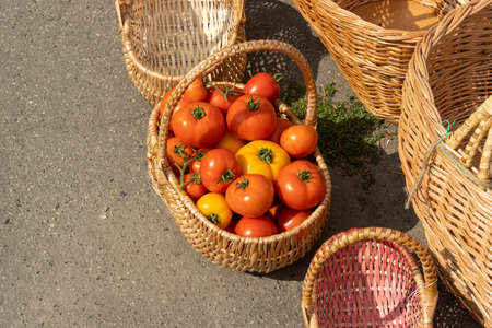 Basket full of tomatoes at local market