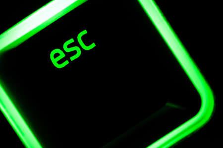 Green illuminated keyboard esc escape key closeup Banque d'images