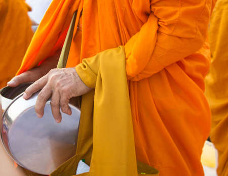Monks receive aims out of morning photo