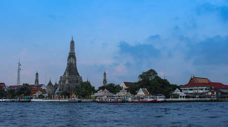 Wat Arun is located along the Chao Phraya River Stock Photo