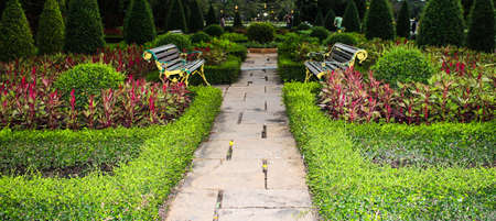 Two benches and flowers in the park Stock Photo