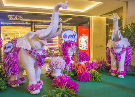 BANGKOK,THAILAND-JUNE6 : Elephant decorated with two white orchid species orchids on display at the event of 7th Siam Paragon Bangkok Royal Orchid Paradise on June 6, 2013 in Bangkok ,Thailand. Editorial