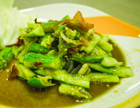 Green papaya salad with cucumber on a plate Stock Photo - 21399506