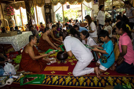 SINGBURI, THAILAND-AUGUST 15  Unidentified priests have been contributing factors to the merit of merit at the temple on August 15, 2013 AmpawanTemple Phrom Buri district  Sing Buri Province, Thailand