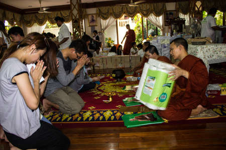 contributing: SINGBURI, THAILAND-AUGUST 15  Unidentified priests have been contributing factors to the merit of merit at the temple on August 15, 2013 AmpawanTemple Phrom Buri district  Sing Buri Province, Thailand