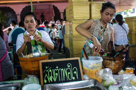SINGBURI, THAILAND-AUGUST 15: unidentified people cooking salad for people to eat on the merit anniversary birthday father Charan at AmpawanTemple on August 15, 2013 AmpawanTemple Phrom Buri district. Sing Buri Province. , Thailand. Stock Photo - 22521212