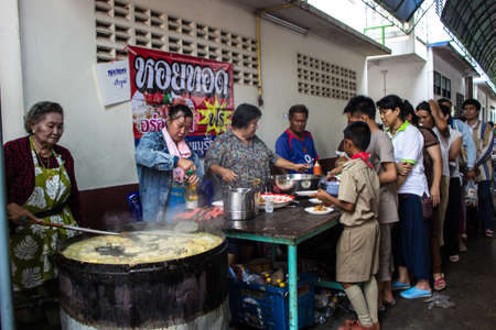 SINGBURI, THAILAND-AUGUST  15: unidentified people are frying oysters, free for people who join the anniversary of birthdays father Charan at AmpawanTemple on August 15, 2013 AmpawanTemple Phrom Buri district  Sing Buri Province,  Thailand  Stock Photo - 22516675