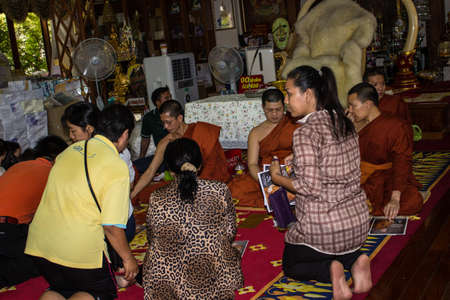 SINGBURI, THAILAND-AUGUST 15 : unidentified people came to the monks at the temple during the birthday celebration Charan at AmpawanTemple on August 15 , 2013 AmpawanTemple Phrom Buri district  Sing Buri Province, Thailand