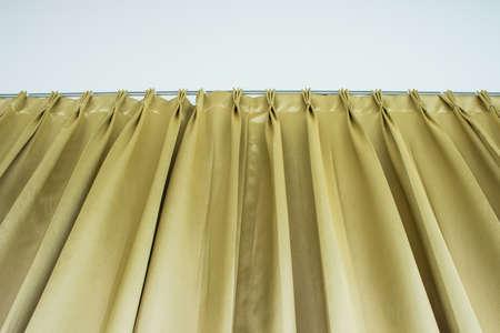 Luce tessuto per tende d'oro per lo sfondo della pagina Web