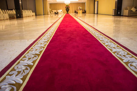 Red carpet with a beautiful pattern for VIP