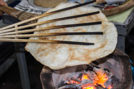 Flour grilled on charcoal. A grilled flour pastry of Thailand.