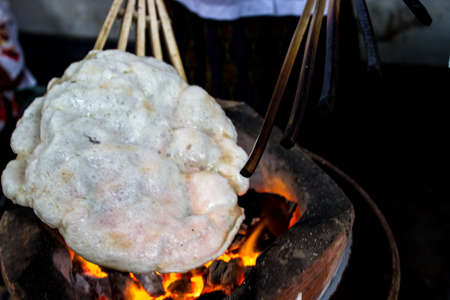 Puffed white grill on the stove, Thailand. Stock Photo