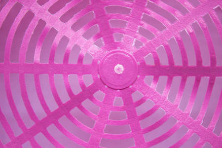 pink plastic basket texture as a background.