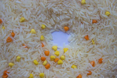 Raw rice with colors on a white background.