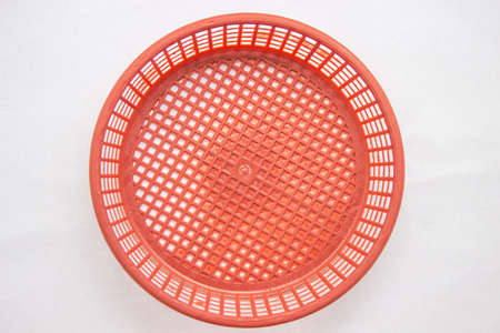 Red plastic basket on a white background. Stock Photo