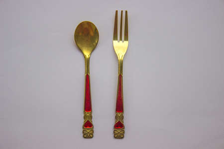 fork and spoon on a white background isolated
