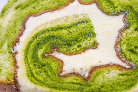 Presentazione di torta t� verde svizzero roll