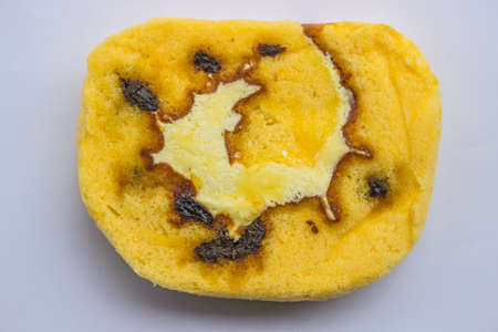 Slide the cake with raisins on white background. Stock Photo