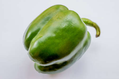 Green pepper on white background, close up Stock Photo