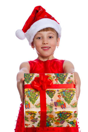 baby open present: The girl on an isolated background holding a gift