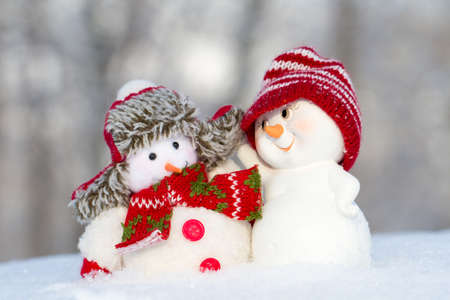 scarf beach: two small cheerful snowman standing next to each other Stock Photo