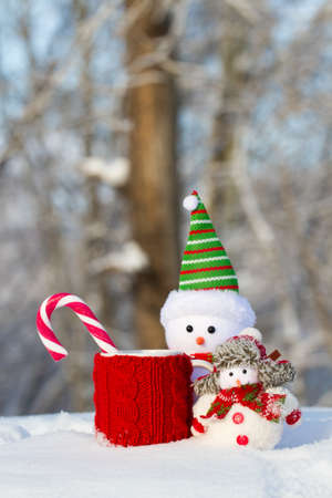 scarf beach: two Snowman with snow on red mug and candy