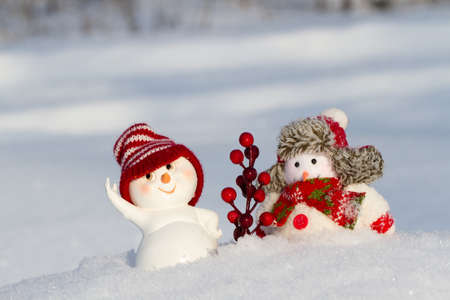 scarf beach: two Snowmen in clothing are next to each other Stock Photo