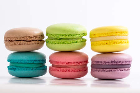french bakery: six colourful French macarons on white background Stock Photo