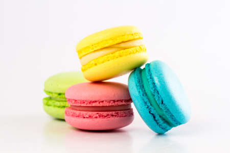 dessert plate: Sweet and colourful french macaroons or macaron on white background Stock Photo