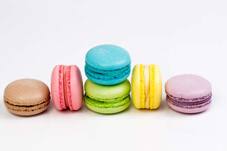 french bakery: Sweet and colourful french macaroons or macaron on white background Stock Photo