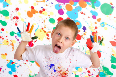 kid smile: The boy with closed fingers indicates the language of color