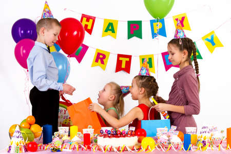congratulate: three girls congratulate the boy. White background, food, happy birthday