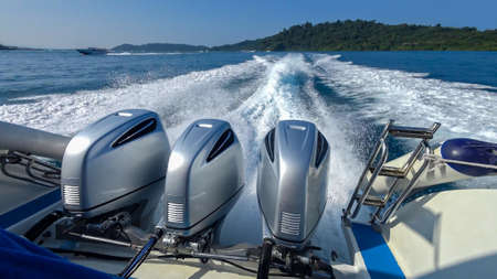outboard: Thailand. Three powerful engines mounted on the speedboat. Andaman Sea.