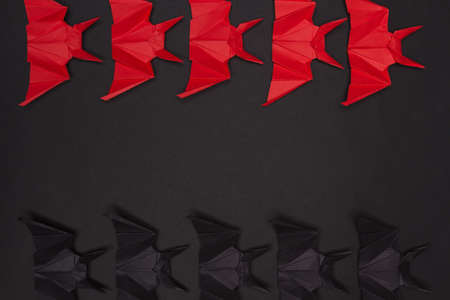 Halloween Background. Black background. Red and black bats