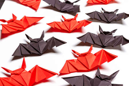 Halloween background. White background. Red and black bats