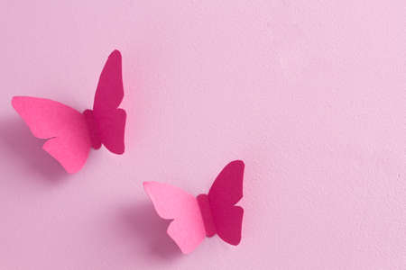 Paper butterflies on a pink background. Love and Valentines day concept. Top view Stock Photo