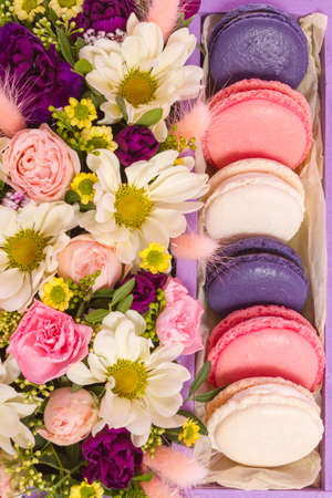 French macaroon cake. Macaroons in a box with flowers